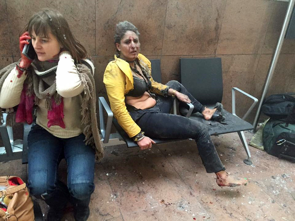 . In this photo provided by Georgian Public Broadcaster and photographed by Ketevan Kardava two women wounded in Brussels Airport in Brussels, Belgium, after explosions were heard Tuesday, March 22, 2016. A developing situation left at least one person and possibly more dead in explosions that ripped through the departure hall at Brussels airport Tuesday, police said. All flights were canceled, arriving planes were being diverted and Belgium\'s terror alert level was raised to maximum, officials said. (Ketevan Kardava/ Georgian Public Broadcaster via AP)