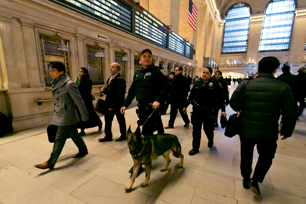 . Metro-North Railroad police officers patrol Grand Central Terminal, in New York,  Tuesday, March 22, 2016. Authorities are increasing security throughout New York City following explosions at the airport and subway system in the Belgian capital of Brussels.  (AP Photo/Richard Drew)
