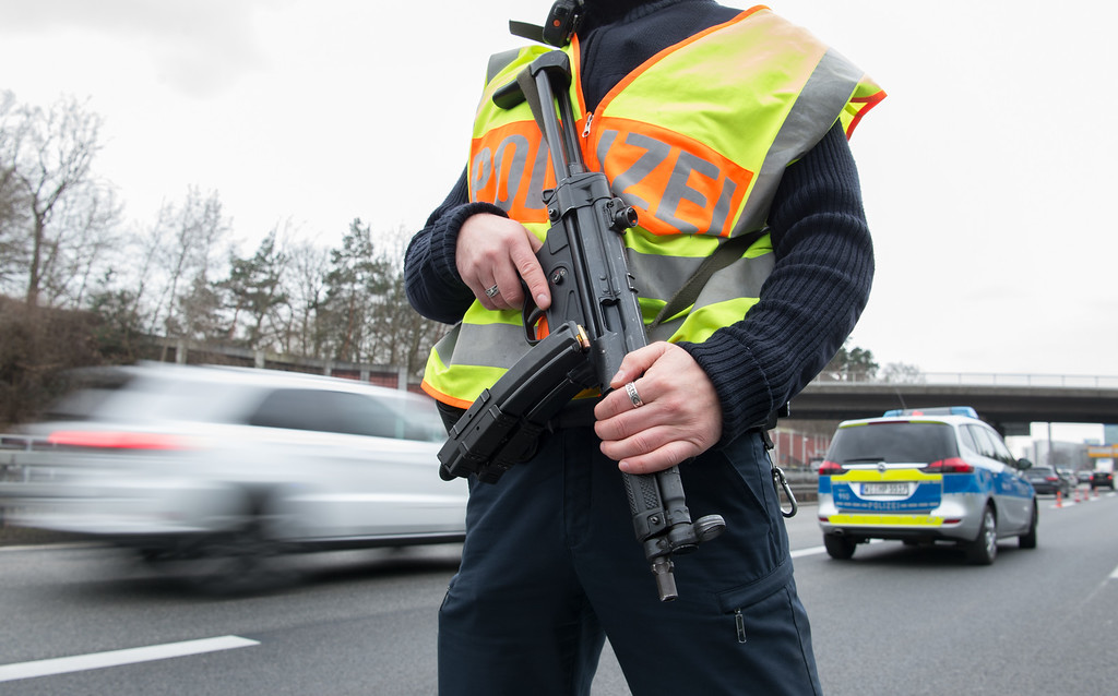 . Police have set up a checkpoint on a road near the airport in Frankfurt,  Germany, Tuesday March 22,  2016. After the attacks in Brussels, the German police ha increased security measures. (Alexander Heinl/dpa via AP)