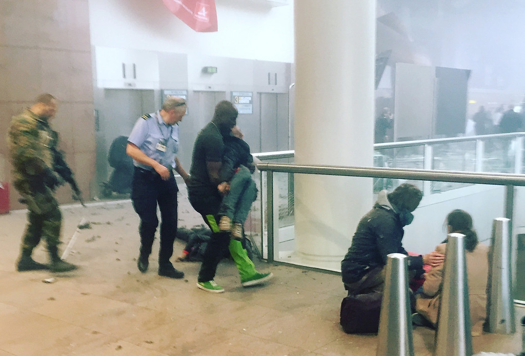 . This photo provided by Georgian Public Broadcaster and photographed by Ketevan Kardava, shows the scene in Brussels Airport in Brussels, Belgium, after explosions were heard Tuesday, March 22, 2016. A developing situation left a number dead in explosions that ripped through the departure hall at Brussels airport Tuesday, police said. All flights were canceled, arriving planes were being diverted and Belgium\'s terror alert level was raised to maximum, officials said. (Ketevan Kardava/ Georgian Public Broadcaster via AP)