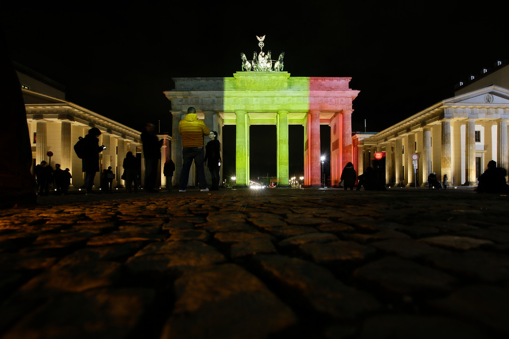. The Brandenburg Gate is illuminated with the Belgium national flag in reaction to the Brussels attacks, in Berlin, Germany, Tuesday, March 22, 2016. (AP Photo/Markus Schreiber)