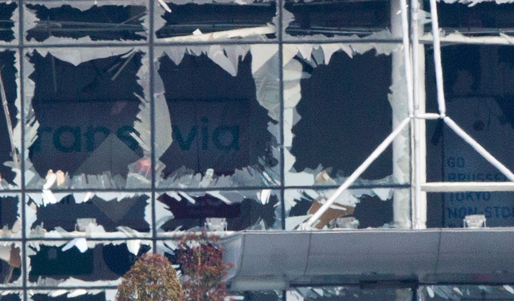 . The blown out facade of the terminal is seen at Zaventem airport, one of the sites of two deadly attacks in Brussels, Belgium, Tuesday, March 22, 2016. Authorities in Europe have tightened security at airports, on subways, at the borders and on city streets after the attacks Tuesday on the Brussels airport and its subway system. (AP Photo/Peter Dejong)