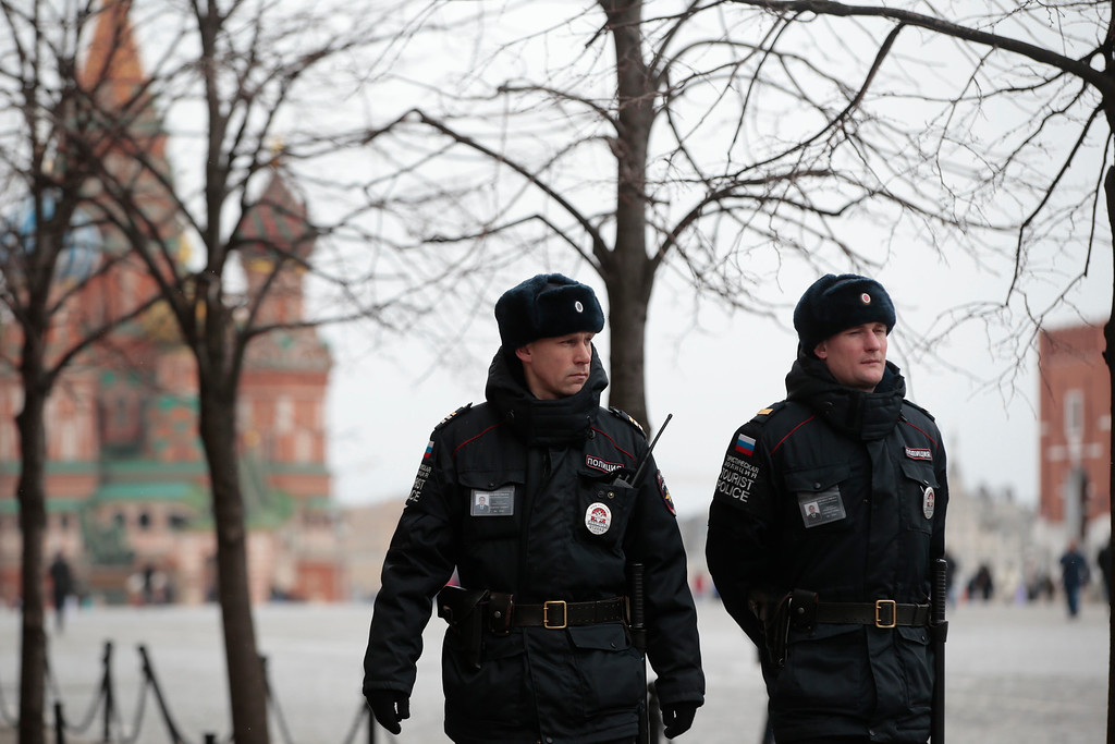 . Tourist police officers patrol the Red Square in Moscow, Russia, Tuesday, March 22, 2016. Authorities in Europe have tightened security at airports, on subways, at the borders and on city streets after deadly attacks Tuesday on the Brussels airport and its subway system. (AP Photo/ Pavel Golovkin)