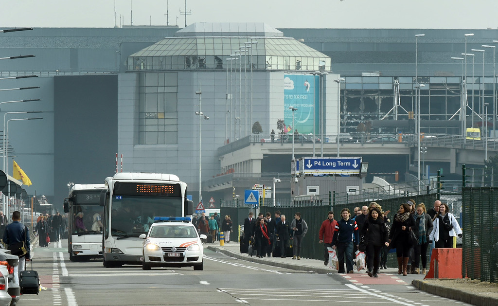 . people are evacuated from Zaventem Airport in Brussels by bus after an explosion on Tuesday, March 22, 2016. Explosions, at least one likely caused by a suicide bomber, rocked the Brussels airport and subway system Tuesday, prompting a lockdown of the Belgian capital and heightened security across Europe. At least 26 people were reported dead. (AP Photo/Geert Vanden Wijngaert)