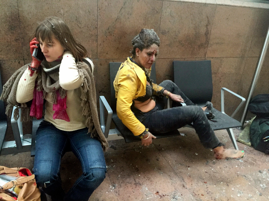 . In this photo provided by Georgian Public Broadcaster and photographed by Ketevan Kardava, injured women are seen in Brussels Airport in Brussels, Belgium, after explosions were heard Tuesday, March 22, 2016. A developing situation left a number dead in explosions that ripped through the departure hall at Brussels airport Tuesday, police said. All flights were canceled, arriving planes were being diverted and Belgium\'s terror alert level was raised to maximum, officials said. (Ketevan Kardava/ Georgian Public Broadcaster via AP)