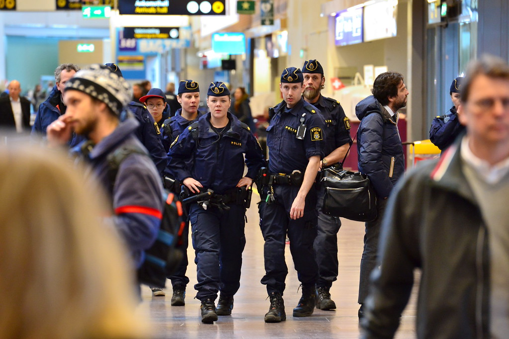 . Swedish police patrol in Arlanda airport outside Stockholm, Sweden, Tuesday, March 22, 2016. More than 200 flights to Brussels have been diverted or canceled after three explosions that authorities are calling terror attacks, according to the flight tracking service Flightradar24. Scores of people are dead after two explosions hit Brussels airport Tuesday morning and a third hit the city\'s Maelbeek metro station. The Brussels airport has been shut down and airport security has been tightened across Europe. (Johan Nilsson/ TT News Agency via AP)