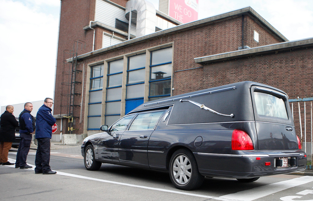 . A hearse parks outside Zaventem Airport in Brussels, Tuesday, March 22, 2016. Bombs struck the Brussels airport and one of the city\'s metro stations Tuesday, killing and wounding dozens of people, as a European capital was again locked down amid heightened security threats. (AP Photo/Michel Spingler)