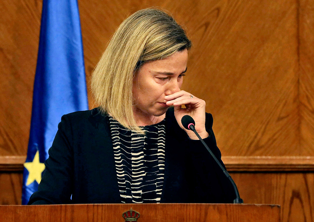 . European Union Foreign Policy Chief Federica Mogherini, reacts to the latest news on the Brussels attacks, during a news conference with Jordanian Foreign Minister Nasser Judeh in Amman, Jordan, Tuesday, March 22, 2016. Mogherini, fighting back tears, has stopped short a news conference in Jordan after saying that ìtoday is a difficult day,î in reference to the Brussels attacks. (AP Photo)