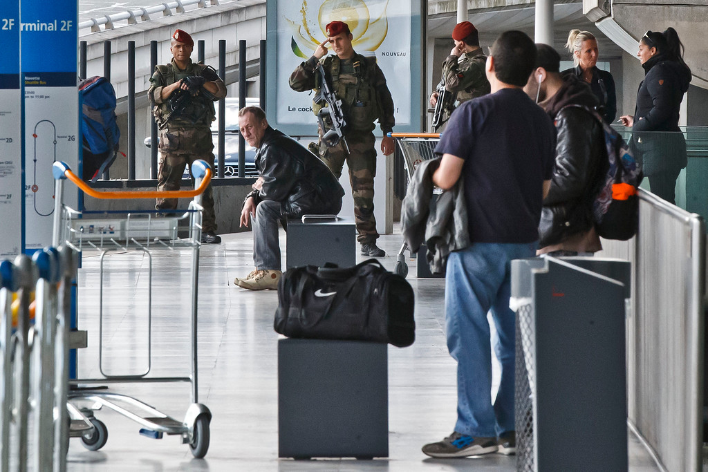 . French soldiers patrol at bus station of Charles de Gaulle airport, in Roissy, north of Paris, Tuesday, March 22, 2016. Authorities are tightening security at airports and on the streets of European cities after attacks on the Brussels airport and subways system that killed at least one person and injured many others. Security has been beefed up in France, Austria, Poland and the Czech Republic. (AP Photo/Michel Euler)