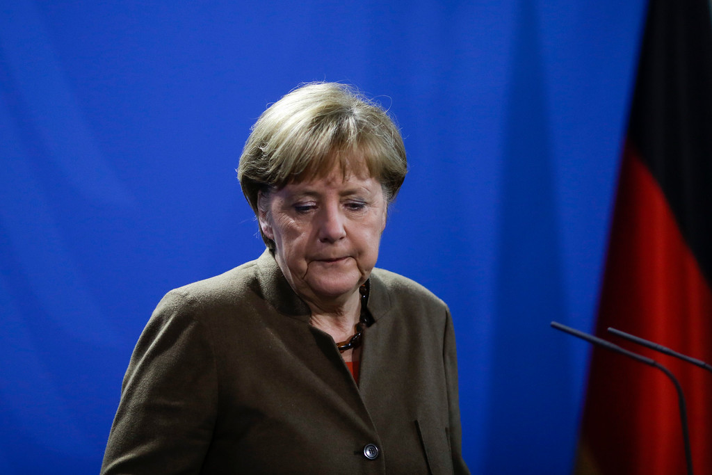 . German Chancellor Angela Merkel leaves the podium after she addressed  the media during a statement on the  attacks in Brussels at the chancellery in Berlin, Germany, Tuesday, March 22, 2016. (AP Photo/Markus Schreiber)