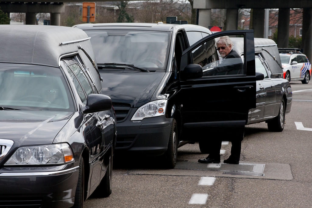 . Three hearses wait to enter Zaventem airport, one of the sites of two deadly attacks in Brussels, Belgium, Tuesday, March 22, 2016. Authorities in Europe have tightened security at airports, on subways, at the borders and on city streets after the attacks Tuesday on the Brussels airport and its subway system. (AP Photo/Peter Dejong)