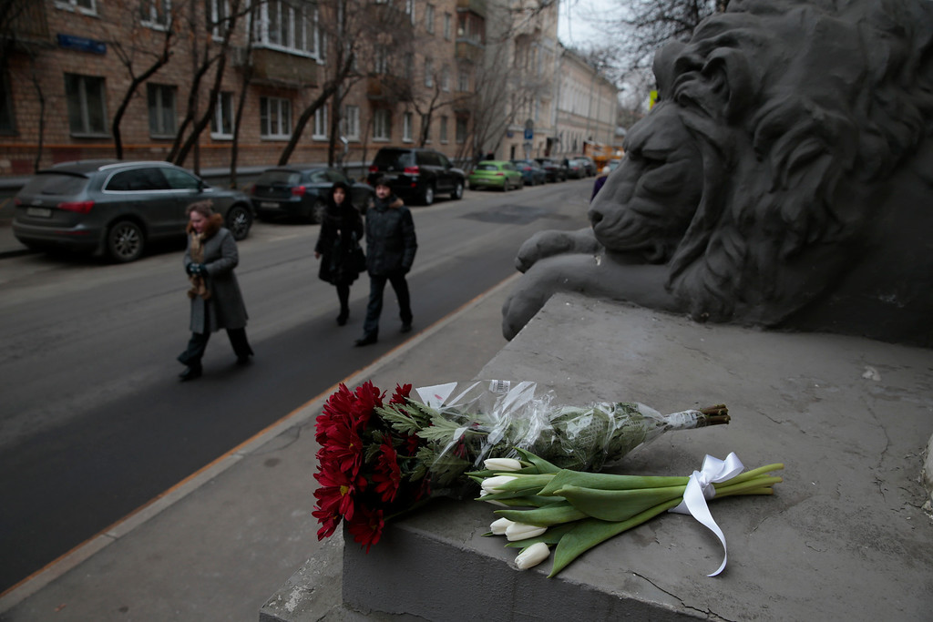 . Flowers are placed outside the embassy of Belgium, in Moscow, Russia, Tuesday, March 22, 2016. Authorities in Europe have tightened security at airports, on subways, at the borders and on city streets after deadly attacks Tuesday on the Brussels airport and its subway system. (AP Photo/Pavel Golovkin)