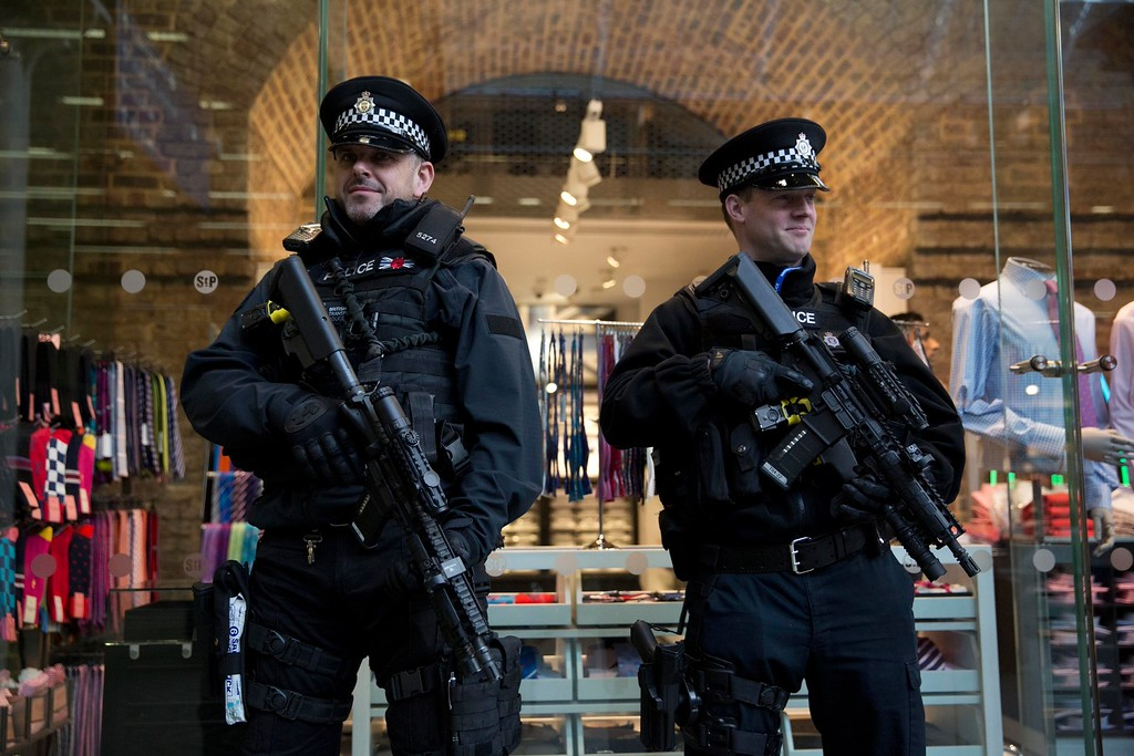 . Armed British police officers stand guard after Eurostar services were suspended on the Brussels route because of the attacks in Belgium, at St Pancras international railway station in London, Tuesday, March 22, 2016. Authorities in Europe and beyond have tightened security at airports, on subways, at the borders and on city streets after deadly attacks Tuesday on the Brussels airport and its subway system. (AP Photo/Matt Dunham)