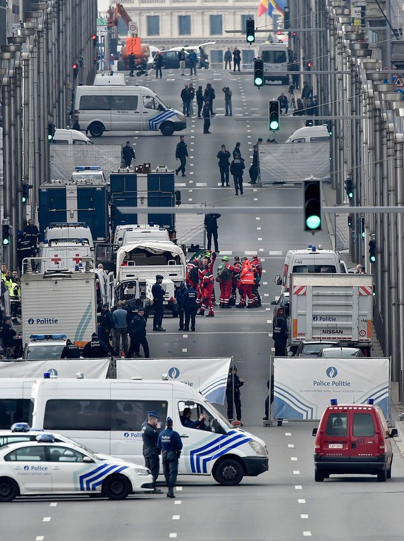 . Police and rescue teams are pictured outside the metro station Maelbeek in Brussels, Tuesday, March 22, 2016. Explosions, at least one likely caused by a suicide bomber, rocked the Brussels airport and its subway system Tuesday, prompting a lockdown of the Belgian capital and heightened security across Europe. (AP Photo/Martin Meissner)