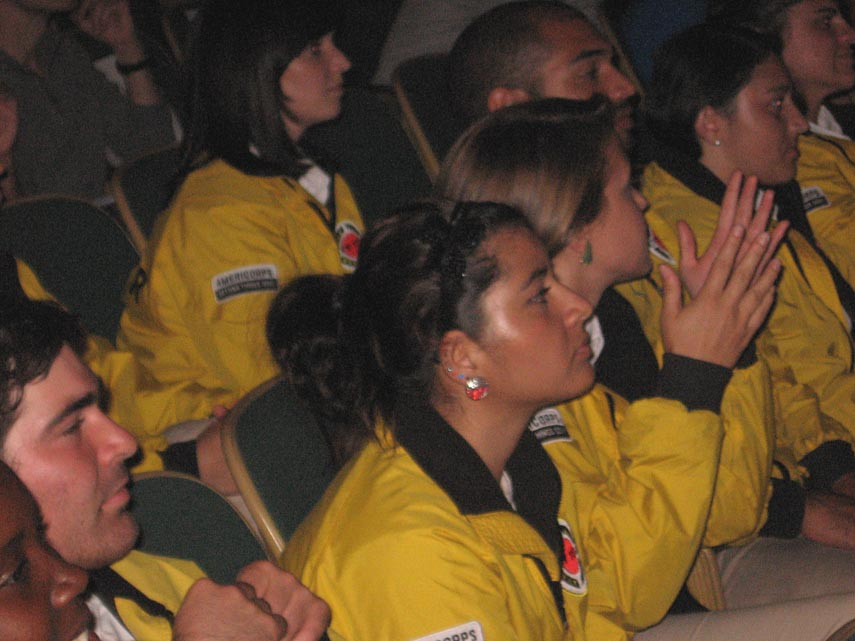 . CityYear members listen intently to surprise speaker Dwight Howard, center for the Los Angeles Lakers.