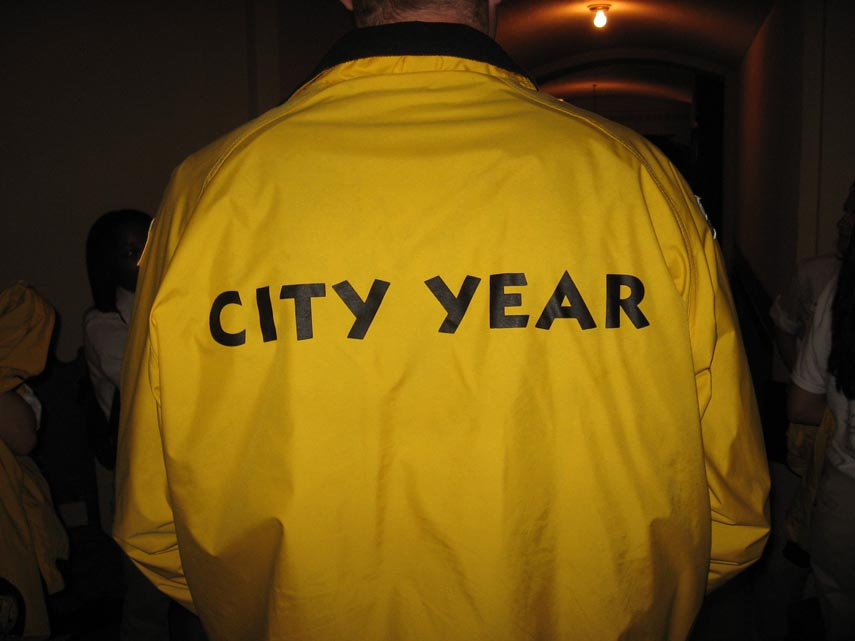 . CityYear members are known by their bright yellow jackets, white shirts and brown work boots.