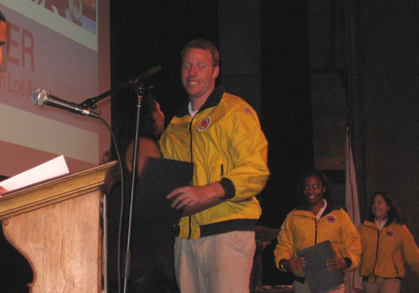 . A CityYear team leader accepts his diploma at the Wilshire-Ebell Theatre on May 31, 2013.