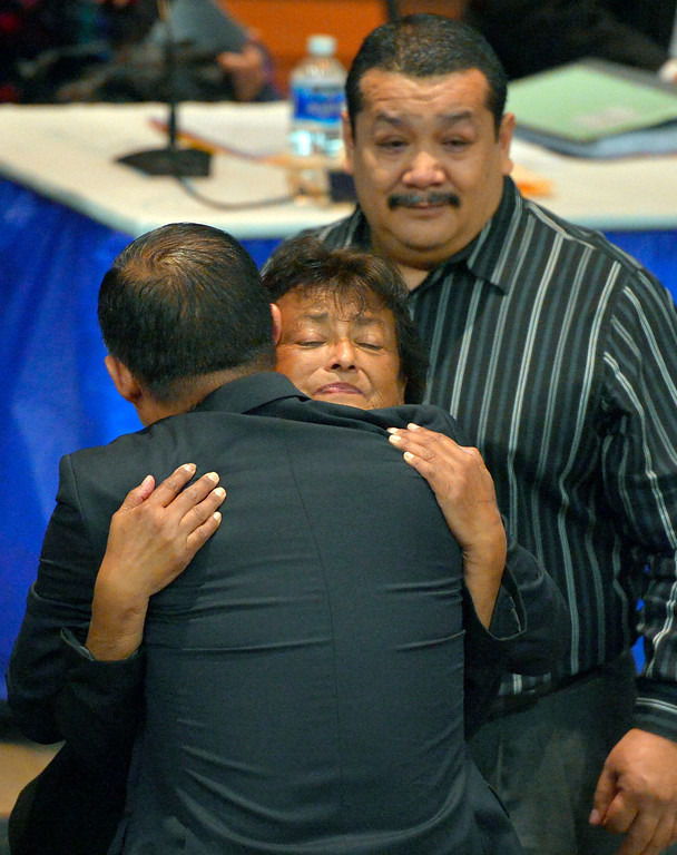 . Dr. Otto Lee, president of LAHC, hugs Aurora Godoy�s mother, Dolores Valles as Godoy�s father Juan Banales looks on at L.A. Harbor College in Harbor City, CA on Wednesday, May 11, 2016. On Wednesday, LAHC officials posthumously awarded an associate degree to Aurora Godoy. Godoy, who was killed in the San Bernardino terror attack in December, was two classes shy of earning her degree. (Photo by Scott Varley, Daily Breeze)