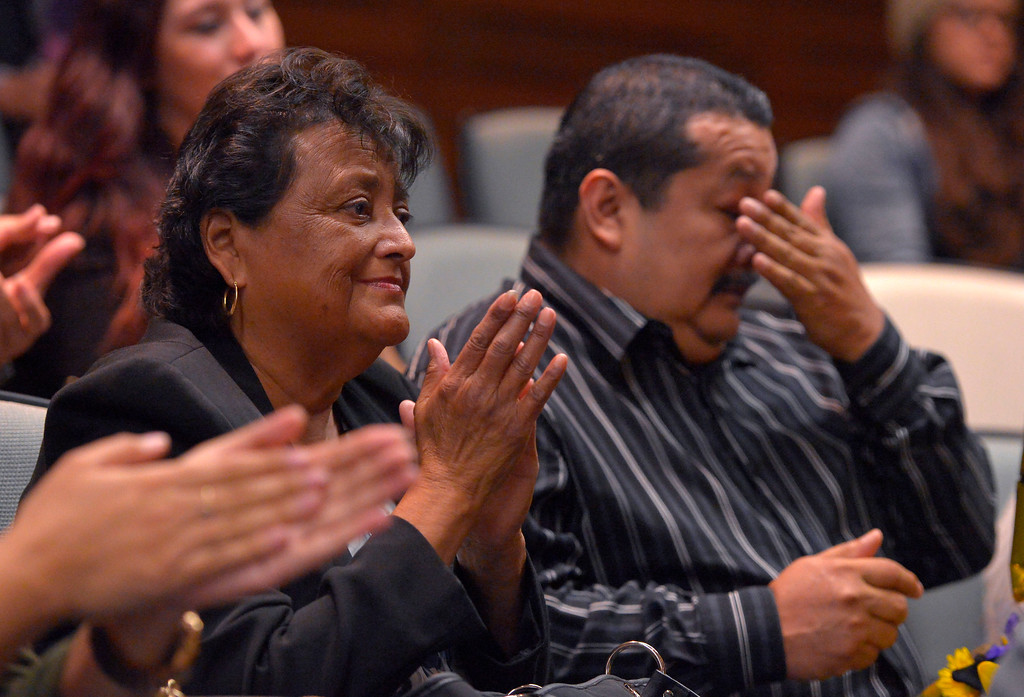 . Aurora Godoy�s parents, Dolores Valles and Juan Banales react as Godoy is posthumously awarded her  Associate Degree in Liberal Arts and Sciences at L.A. Harbor College in Harbor City, CA on Wednesday, May 11, 2016. On Wednesday, LAHC officials posthumously awarded an associate degree to Aurora Godoy. Godoy, who was killed in the San Bernardino terror attack in December, was two classes shy of earning her degree. (Photo by Scott Varley, Daily Breeze)