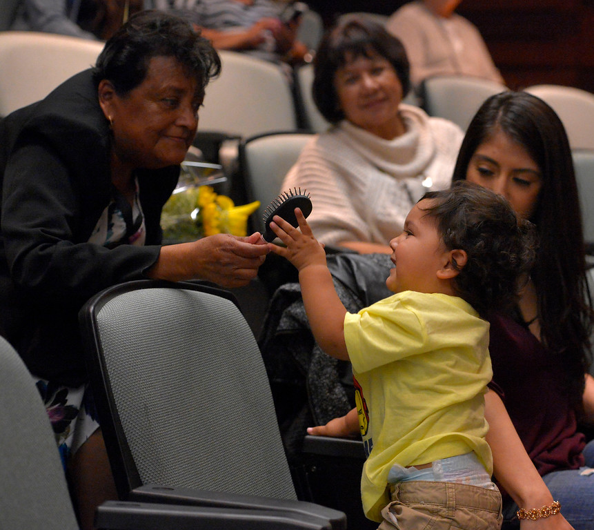 . 2-year-old Alexander Godoy smiles as his grandmother Dolores Valles hands him a brush at L.A. Harbor College in Harbor City, CA on Wednesday, May 11, 2016. On Wednesday, LAHC officials posthumously awarded an Associate Degree in Liberal Arts and Sciences to Aurora Godoy. Godoy, who was killed in the San Bernardino terror attack in December, was two classes shy of earning her degree. (Photo by Scott Varley, Daily Breeze)