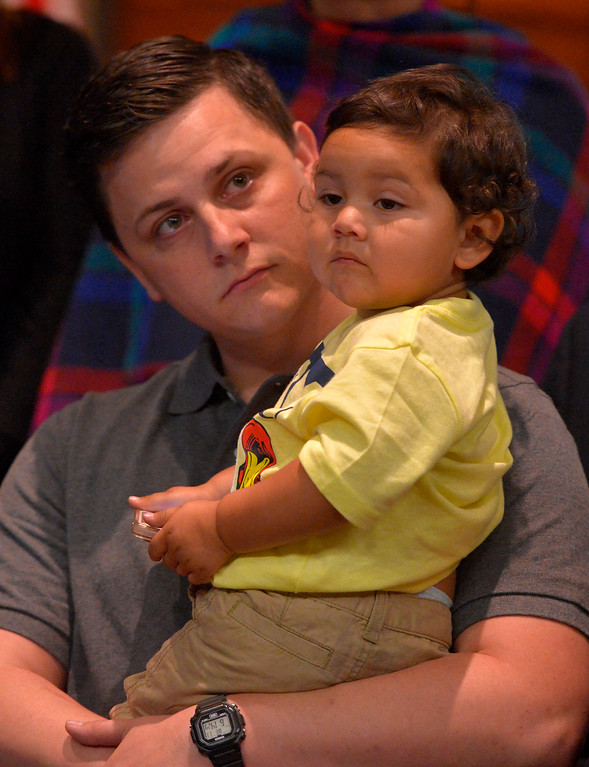 . James Godoy holds his 2-year-old son, Alexander, as his late wife is honored at L.A. Harbor College in Harbor City, CA on Wednesday, May 11, 2016. On Wednesday, LAHC officials posthumously awarded an Associate Degree in Liberal Arts and Sciences to Aurora Godoy. Godoy, who was killed in the San Bernardino terror attack in December, was two classes shy of earning her degree. (Photo by Scott Varley, Daily Breeze)
