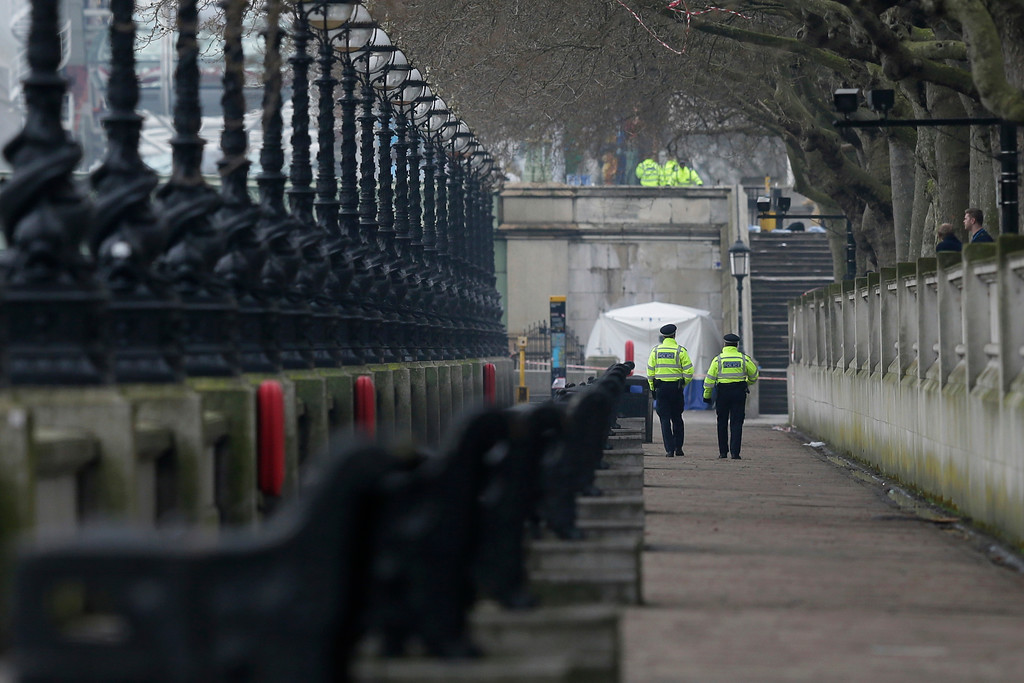 . Police secure the embankment area near the houses of parliament in London, as forensic work continues following a terror attack Wednesday in London, early Thursday March 23, 2017.   On Wednesday a knife-wielding man went on a deadly rampage, first driving a car into pedestrians then stabbing a police officer to death before being fatally shot by police within Parliament\'s grounds in London.  Five people were killed, including the assailant. (AP Photo / Tim Ireland)