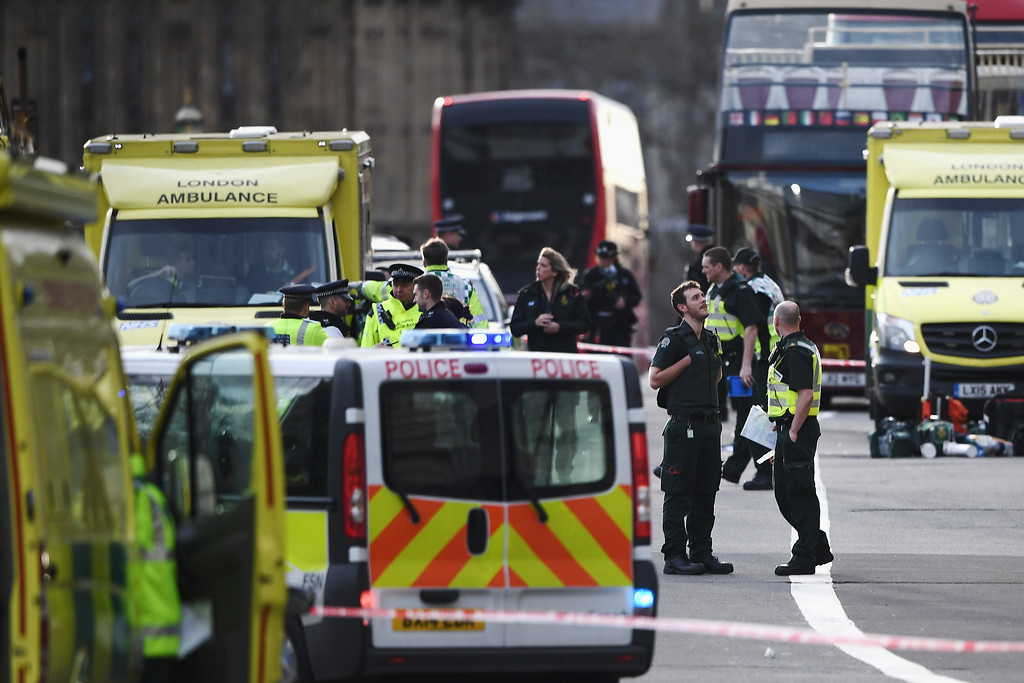 . LONDON, ENGLAND - MARCH 22:  Emergency services vehicles seen on Westminster Bridge on March 22, 2017 in London, England. A police officer was stabbed near to the British Parliament and the alleged assailant shot by armed police. Scotland Yard also reported an incident on Westminster Bridge where one woman has been killed and several people seriously injured by a car.  (Photo by Carl Court/Getty Images)