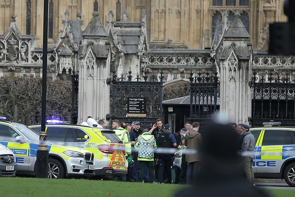 ". Armed police officers stand guard, as ambulance paramedics arrive at the Carriage Gates entrance of the Houses of Parliament in central London on March 22, 2017, during an emergency incident. British police shot a suspected attacker outside the Houses of Parliament in London on Wednesday after an officer was stabbed in what police said was a ""terrorist\"" incident. One woman has died and others have \""catastrophic\"" injuries following a suspected terror attack outside the British parliament, local media reported on Wednesday citing a junior doctor. (DANIEL LEAL-OLIVAS/AFP/Getty Images)"
