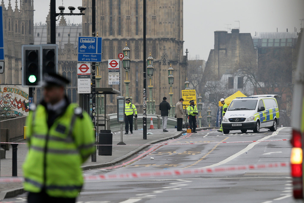 . Police work at the scene of a terror attack in London, Thursday March 23, 2017.  On Wednesday a knife-wielding man went on a deadly rampage, first driving a car into pedestrians then stabbing a police officer to death before being fatally shot by police within Parliament\'s grounds in London. Five people were killed, including the assailant. (AP Photo/Tim Ireland)