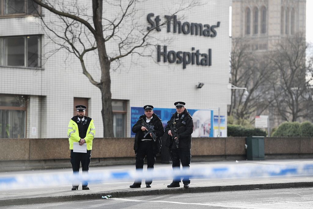 . LONDON, ENGLAND - MARCH 22:  Armed police officers seen outside St Thomas\' hospital near Westminster Bridge on March 22, 2017 in London, England. A police officer was stabbed near to the British Parliament and the alleged assailant shot by armed police. Scotland Yard also reported an incident on Westminster Bridge where one woman has been killed and several people seriously injured by a car.  (Photo by Carl Court/Getty Images)