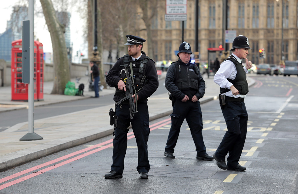 . LONDON, ENGLAND - MARCH 22:  Armed officers attend to the scene outside Westminster Bridge and the Houses of Parliament on March 22, 2017 in London, England.  A police officer has been stabbed near to the British Parliament and the alleged assailant shot by armed police. Scotland Yard report they have been called to an incident on Westminster Bridge where several people have been injured by a car.  (Photo by Jack Taylor/Getty Images)
