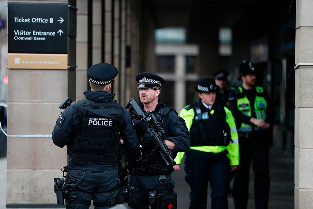 . Armed police secure the area across the road from the Palace of Westminster housing the Houses of Parliament in central London on March 23, 2017 after Westminster bridge reopened following its closure by security services during and after the March 22 terror attack at the British parliament.  Britain\'s parliament reopened on Thursday with a minute\'s silence in a gesture of defiance a day after an attacker sowed terror in the heart of Westminster, killing three people before being shot dead. Sombre-looking lawmakers in a packed House of Commons chamber bowed their heads and police officers also marked the silence standing outside the headquarters of London\'s Metropolitan Police nearby. (ADRIAN DENNIS/AFP/Getty Images)