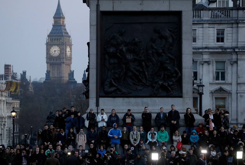 . People observe a minutes silence at a vigil for the victims of Wednesday\'s attack, at Trafalgar Square in London, Thursday, March 23, 2017. The Islamic State group has claimed responsibility for an attack by a man who plowed an SUV into pedestrians and then stabbed a police officer to death on the grounds of Britain\'s Parliament. Mayor Sadiq Khan called for Londoners to attend a candlelit vigil at Trafalgar Square on Thursday evening in solidarity with the victims and their families and to show that London remains united. (AP Photo/Matt Dunham)