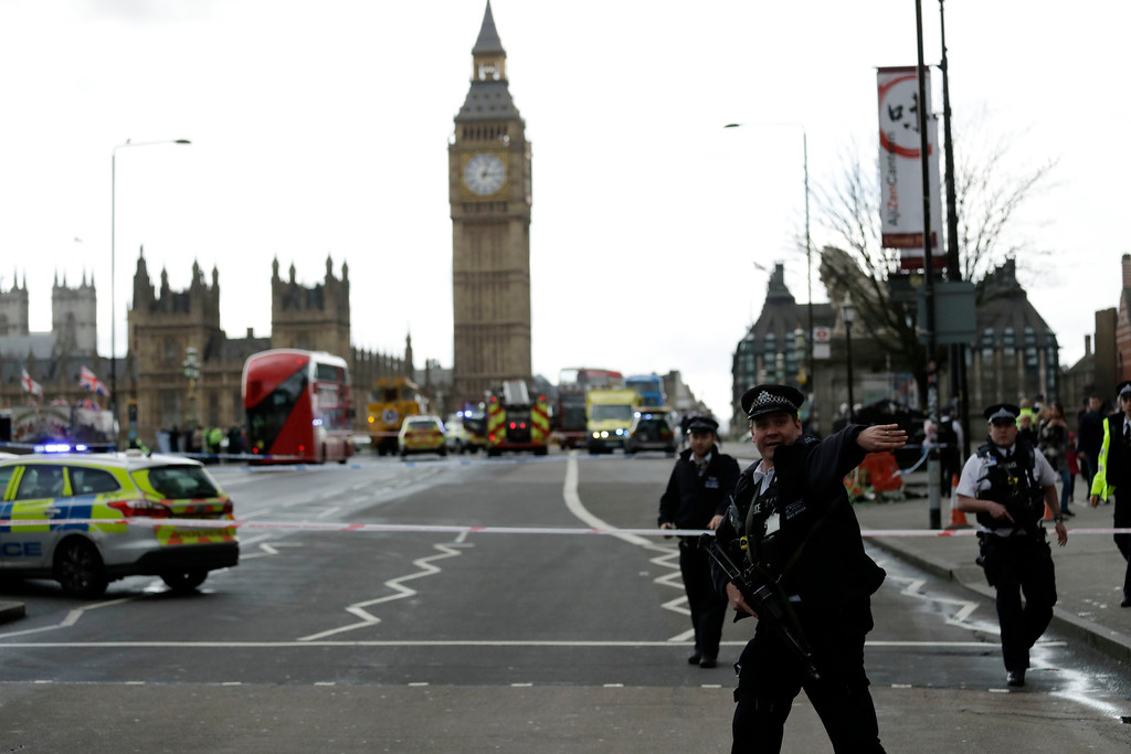 ". Police secure the area on the south side of Westminster Bridge close to the Houses of Parliament in London, Wednesday, March 22, 2017. The leader of Britain\'s House of Commons says a man has been shot by police at Parliament. David Liddington also said there were ""reports of further violent incidents in the vicinity.\"" London\'s police said officers had been called to a firearms incident on Westminster Bridge, near the parliament. Britain\'s MI5 says it is too early to say if the incident is terror-related. (AP Photo/Matt Dunham)"