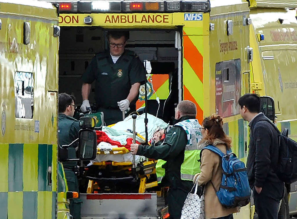 ". Paramedics load a victim into the back of an ambulance as members of the emergency services work on Westminster Bridge, alonside the Houses of Parliament in central London on March 22, 2017, during an emergency incident. British police shot a suspected attacker outside the Houses of Parliament in London on Wednesday after an officer was stabbed in what police said was a ""terrorist\"" incident. (NIKLAS HALLE\'N/AFP/Getty Images)"