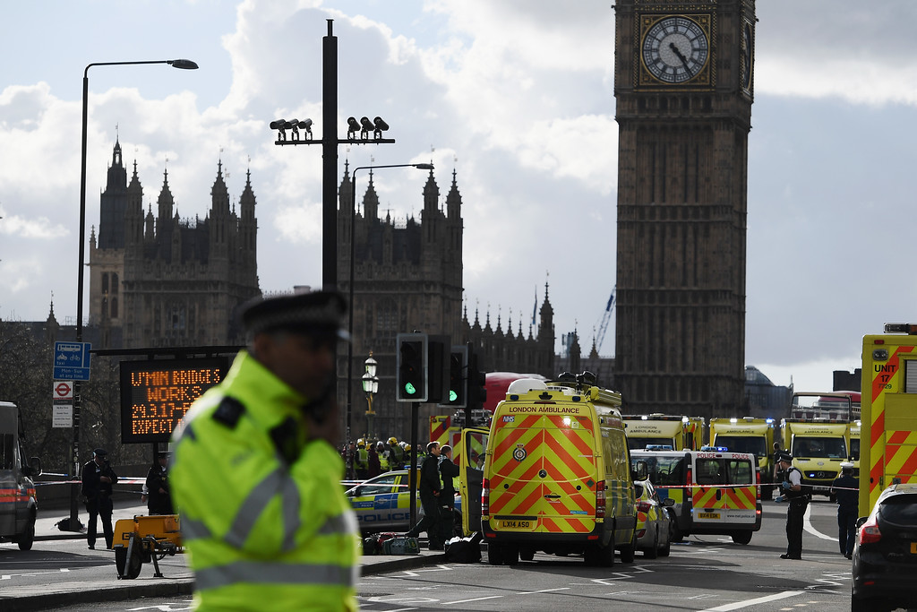. LONDON, ENGLAND - MARCH 22:  Ambulances, police vehicles and emergency services seen on Westminster Bridge on March 22, 2017 in London, England. A police officer was stabbed near to the British Parliament and the alleged assailant shot by armed police. Scotland Yard also reported an incident on Westminster Bridge where one woman has been killed and several people seriously injured by a car.  (Photo by Carl Court/Getty Images)