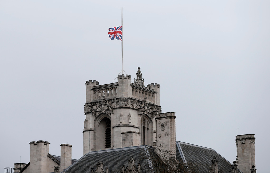 . A flag flies at half staff above the Supreme Court in Westminster, following Wednesday\'s attack in London, Thursday March 23, 2017.   On Wednesday a knife-wielding man went on a deadly rampage, first driving a car into pedestrians before stabbing a police officer to death before being fatally shot by police within Parliament\'s grounds in London.  Five people were killed, including the assailant.(AP Photo/Kirsty Wigglesworth)