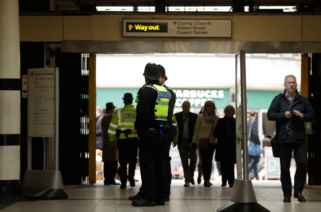 . Police officers watch over Embankment underground train station in London, Thursday, March 23, 2017. On Wednesday a man went on a deadly rampage, first driving a car into pedestrians then stabbing a police officer to death before being fatally shot by police within Parliament\'s grounds in London. (AP Photo/Matt Dunham)