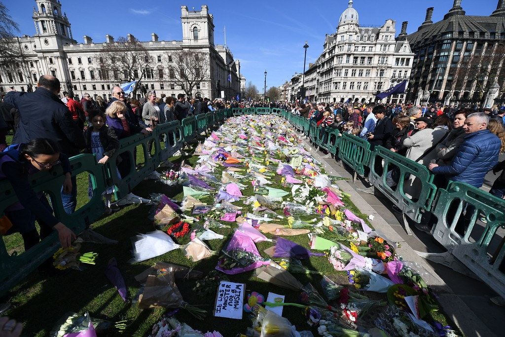 . Floral tributes left in honour of the victims of the London terror attack on March 22, are pictured in Parliament Square in Westminster, central London on March 25, 2017 as people take part in a march organised by Unite for Europe against Britain leaving the European Union. (CHRIS J RATCLIFFE/AFP/Getty Images)