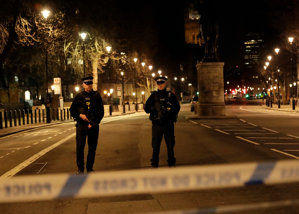 ". Two policemen stand guard at a cordoned off area on the way to the Houses of Parliament in central London, Wednesday, March 22, 2017. London police say they are treating a gun and knife incident at Britain\'s Parliament ""as a terrorist incident until we know otherwise.\"" The Metropolitan Police says in a statement that the incident is ongoing. It is urging people to stay away from the area. Officials say a man with a knife attacked a police officer at Parliament and was shot by officers. Nearby, witnesses say a vehicle struck several people on the Westminster Bridge. (AP Photo/ Matt Dunham)"