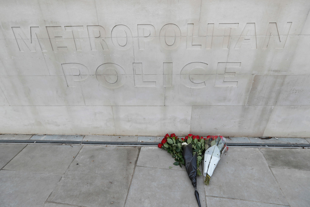 . Flowers are left at New Scotland Yard following Wednesday\'s attack in London, Thursday March 23, 2017. On Wednesday a man went on a deadly rampage, first driving a car into pedestrians then stabbing a police officer to death before being fatally shot by police within the grounds of the Houses of Parliament. (AP Photo/Kirsty Wigglesworth)