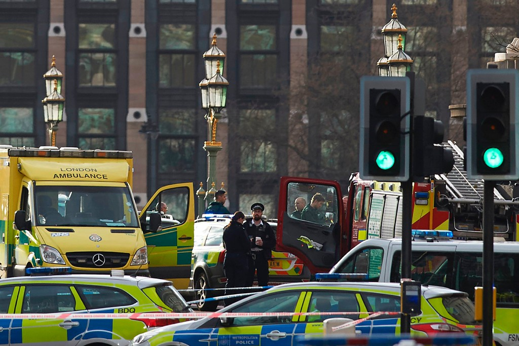 ". Members of the emergency services work on Westminster Bridge, alongside the Houses of Parliament in central London on March 22, 2017 during an emergency incident. British police shot a suspected attacker outside the Houses of Parliament in London on Wednesday after an officer was stabbed in what police said was a ""terrorist\"" incident. One woman has died and others have \""catastrophic\"" injuries following a suspected terror attack outside the British parliament, local media reported on Wednesday citing a junior doctor. (NIKLAS HALLE\'N/AFP/Getty Images)"