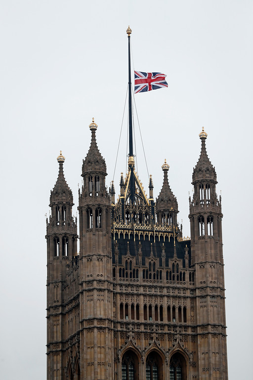 . The flag flies at half staff above The House of Lords following Wednesday\'s attack in London, Thursday March 23, 2017.   On Wednesday a knife-wielding man went on a deadly rampage, first driving a car into pedestrians then stabbing a police officer to death before being fatally shot by police within Parliament\'s grounds in London.  Five people were killed, including the assailant.(AP Photo/Kirsty Wigglesworth)