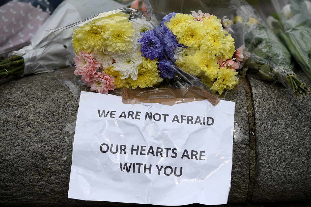. LONDON, ENGLAND - MARCH 23:  Floral tributes are left near Parliament Square on March 23, 2017 in London, England.  Four people have been killed and around 40 people injured following yesterday\'s attack by the Houses of Parliament in Westminster.  (Photo by Carl Court/Getty Images)