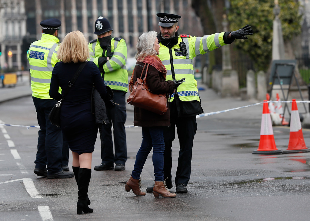 . Police direct pedestrians around a cordon in place following Wednesday\'s terror attack, in London,Thursday March 23, 2017.   On Wednesday a knife-wielding man went on a deadly rampage, first driving a car into pedestrians before stabbing a police officer to death before being fatally shot by police within Parliament\'s grounds in London.  Five people were killed, including the assailant. (AP Photo/Kirsty Wigglesworth)