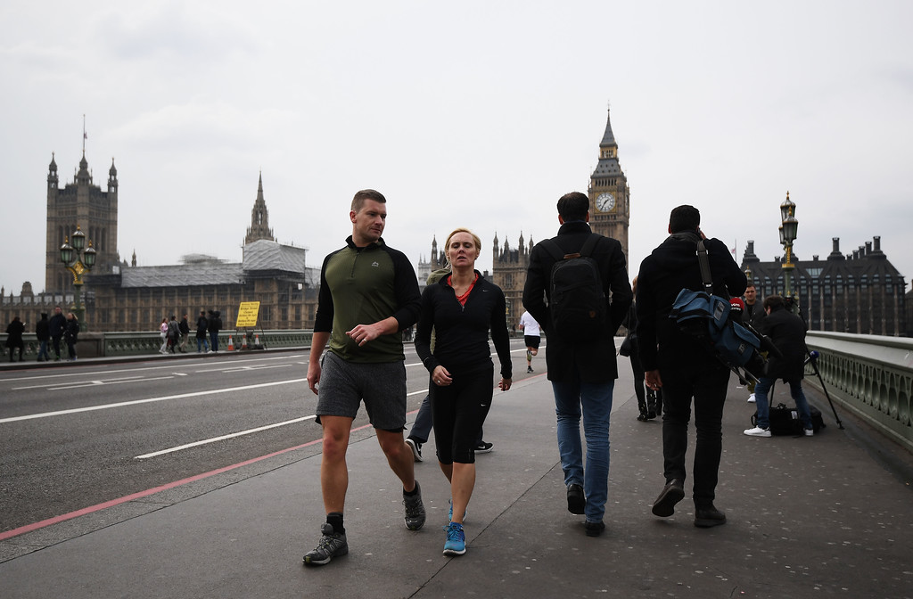 . LONDON, ENGLAND - MARCH 23:  People walk over Westminster Bridge as it is opened to the public on March 23, 2017 in London, England.  Four people have been killed and around 40 people injured following yesterday\'s attack by the Houses of Parliament in Westminster.  (Photo by Carl Court/Getty Images)