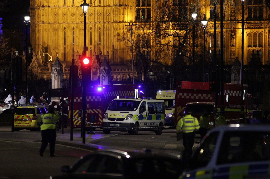 ". British police officers stand on duty as forensics officers work outside the Carriage Gates entrance of the Houses of Parliament in Westminster, central London on March 22, 2017, in the aftermath of a terror incident. Three people were killed and 20 injured in a ""terrorist\"" attack outside the British parliament Wednesday when a man mowed down pedestrians, then stabbed a police officer before being shot dead. The car struck pedestrians on Westminster Bridge, a popular spot with tourists because of its views of Big Ben, before crashing into the railings outside the heavily guarded parliament building in the heart of the British capital. (DANIEL LEAL-OLIVAS/AFP/Getty Images)"