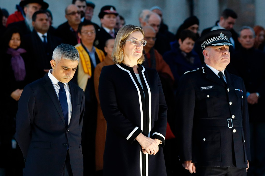 . (L-R) London Mayor Sadiq Khan, British Home Secretary Amber Rudd and Acting Commissioner of the Metropolitan Police Service Craig Mackey lead a vigil in Trafalgar Square in central London on March 23, 2017 in solidarity with the victims of the March 22 terror attack at the British parliament and on Westminster Bridge.  Britain\'s parliament reopened on Thursday with a minute\'s silence in a gesture of defiance a day after an attacker sowed terror in the heart of Westminster, killing three people before being shot dead. Sombre-looking lawmakers in a packed House of Commons chamber bowed their heads and police officers also marked the silence standing outside the headquarters of London\'s Metropolitan Police nearby. (ADRIAN DENNIS/AFP/Getty Images)