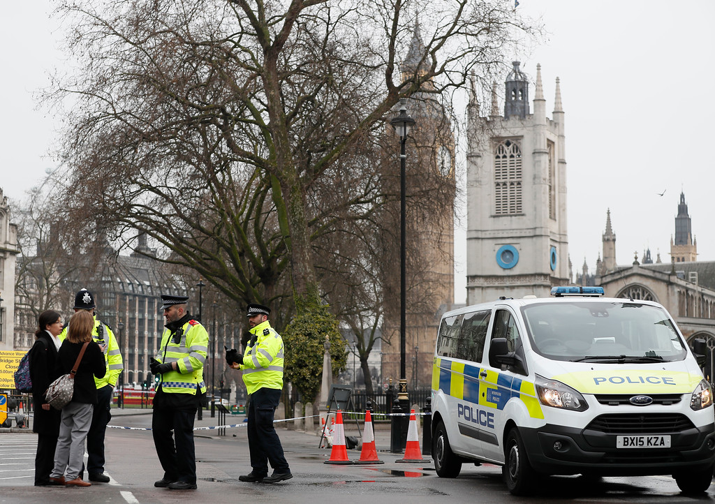 . Police direct pedestrians around a cordon in place following Wednesday\'s terror attack, in London, Thursday March 23, 2017.  On Wednesday a knife-wielding man went on a deadly rampage, first  driving a car into pedestrians before stabbing a police officer to death and then was fatally shot by police within Parliament\'s grounds in London.  Five people were killed, including the assailant.(AP Photo/Kirsty Wigglesworth)