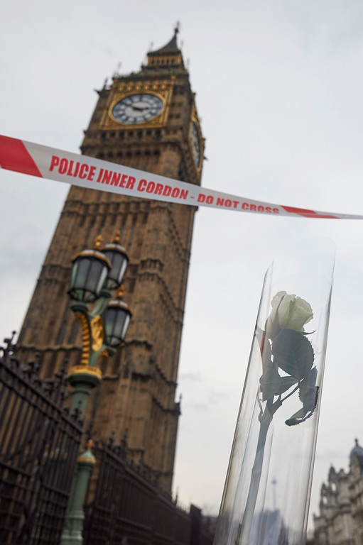. A flower left in tribute to the victims of the March 22 terror attack is seen next to the Palace of Westminster that houses the Houses of Parliament in central London on March 23, 2017.  Britain\'s parliament reopened on Thursday with a minute\'s silence in a gesture of defiance a day after an attacker sowed terror in the heart of Westminster, killing three people before being shot dead. Sombre-looking lawmakers in a packed House of Commons chamber bowed their heads and police officers also marked the silence standing outside the headquarters of London\'s Metropolitan Police nearby. (NIKLAS HALLE\'N/AFP/Getty Images)
